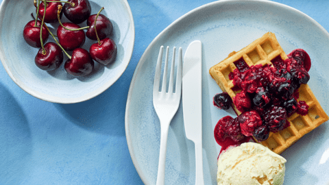 Toasted waffles with smashed berries and ice cream