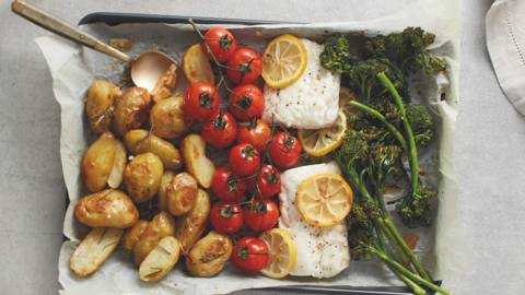 One-pot roasted cod with Jersey Royals, balsamic tomatoes and broccoli