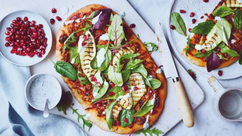 Flatbread pizzas with lamb, courgette and fresh spring leaves