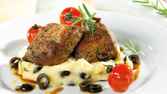 Lamb steaks with mashed potato and olives