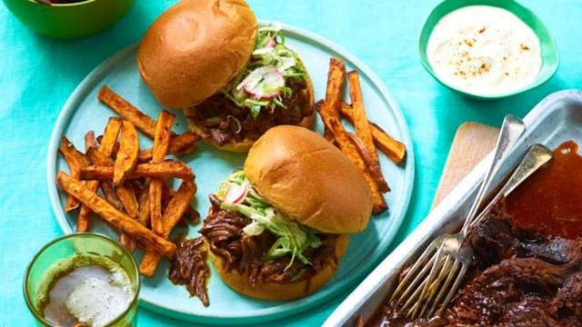 Tennessee brisket bun with slaw and sweet potato fries