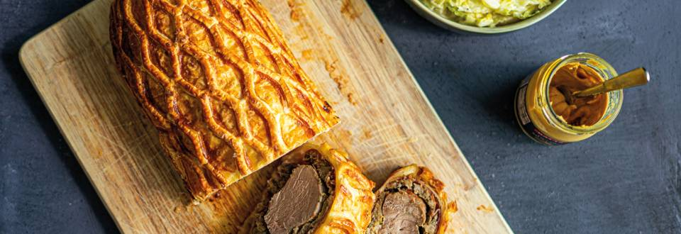 Pork wellington with cabbage in a cream and mustard sauce